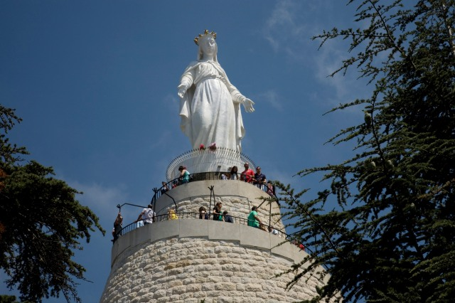 People visit the Shrine of Our Lady of Lebanon in 2012 in the village of Harissa near Beirut. Muslims and Christians alike come to the shrine. (CNS/Dalia Khamissy)