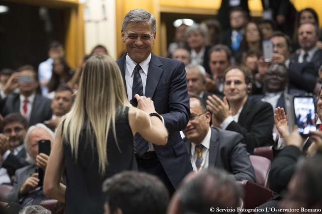 """U.S. actor George Clooney attends a meeting of Scholas Occurrentes at the Vatican May 29. Clooney met Pope Francis at the event. The Scholas Occurrentes organization, which the pope also supported as archbishop of Buenos Aires, promotes a """"culture of encounter"""" through art, sports and technology. (CNS/L'Osservatore Romano via EPA)"""