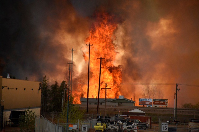 Flames from a wildfire rise in an industrial area of Fort McMurray, Alberta, May 4. The entire city has been evacuated because of the wildfire. (CNS photo/courtesy CBC News via Reuters)