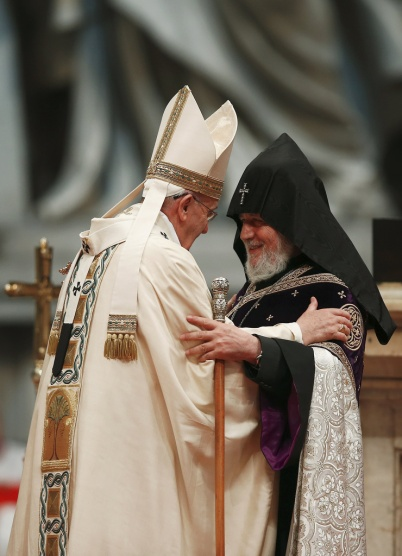 Pope Francis embraces Catholicos Karekin II, patriarch of the Armenian Apostolic Church, during a 2015 Mass in St. Peter's Basilica at the Vatican to mark the 100th anniversary of the Armenian genocide. Pope Francis visits Armenia June 24-26. (CNS/Reuters)