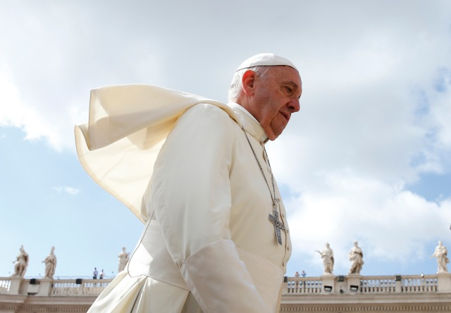 Pope Francis arrives to lead his general audience in St. Peter's Square June 15. (CNS/Paul Haring)
