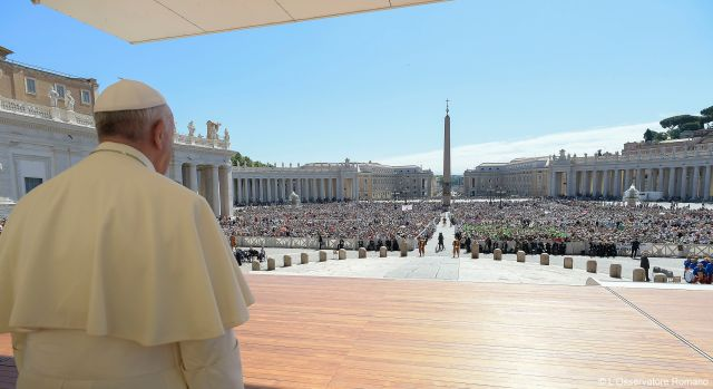 Pope Francis looks out on the crowd during a special jubilee audience in St. Peter's Square at the Vatican June 18. The pope is holding additional audiences during the Holy Year of Mercy. (CNS/L'Osservatore Romano)