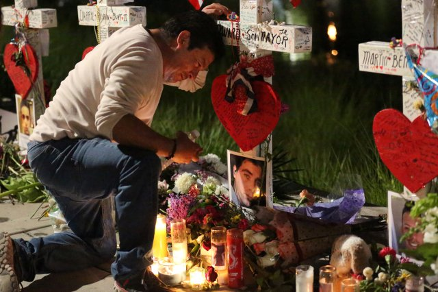 Jose Louis Morales cries as he kneels at a makeshift memorial for his brother, Edward Sotomayor Jr., and other victims of the Pulse night club shootings in Orlando, Fla. (CNS/Reuters)