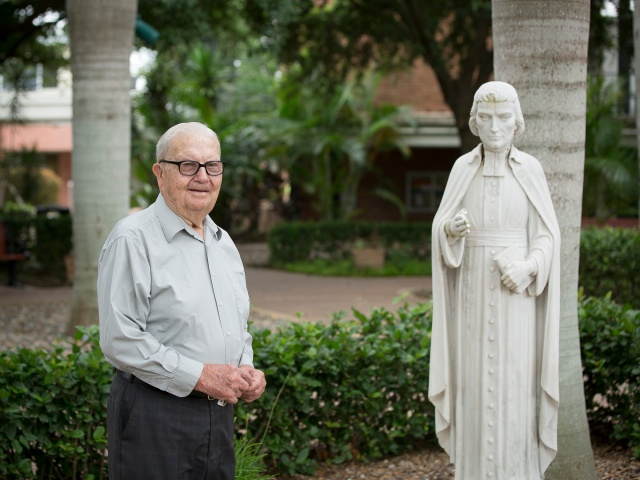 Marist Brother Paul Phillipp on the campus of St. Joseph Academy in Brownsville, Texas. (CNS/Tyler Orsburn)