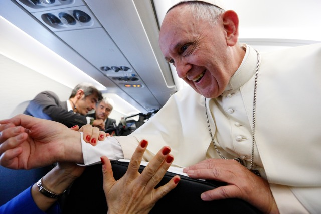 Pope Francis greets reporters aboard his flight from Rome to Yerevan, Armenia, June 24. (CNS/Paul Haring)