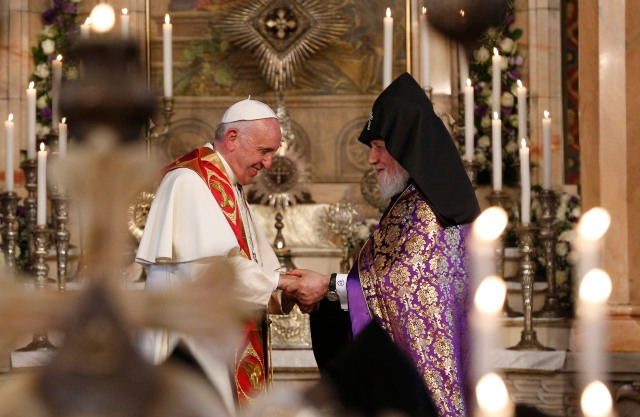 Pope Francis exchanges greetings with Catholicos Karekin II, patriarch of the Armenian Apostolic Church, as they visit the Armenian Apostolic Cathedral at Etchmiadzin in Vagharshapat, Armenia, June 24. (CNS/Paul Haring)