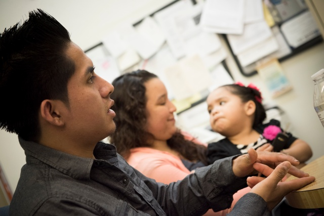 Jose Aguilar, seen with his wife and daughter, sits for an interview. He was a child when he and his family entered the United States without legal permission. A Catholic Charities program in Trenton, N.J., helped him attain legal status through the Deferred Action for Childhood Arrivals program. (CNS/Jeff Bruno, The Monitor)