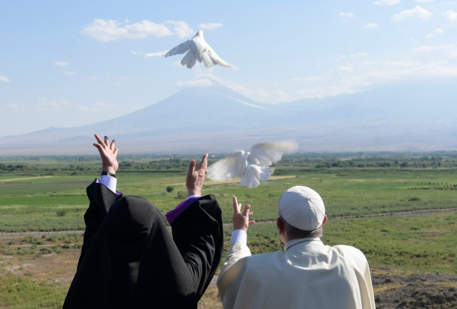 Pope Francis and Catholicos Karekin II, patriarch of the Armenian Apostolic Church, release doves from the Khor Virap monastery near Lusarat village in Armenia June 26. In the background is Mount Ararat, believed to be where Noah's Ark came to rest. (CNS/L'Osservatore Romano)
