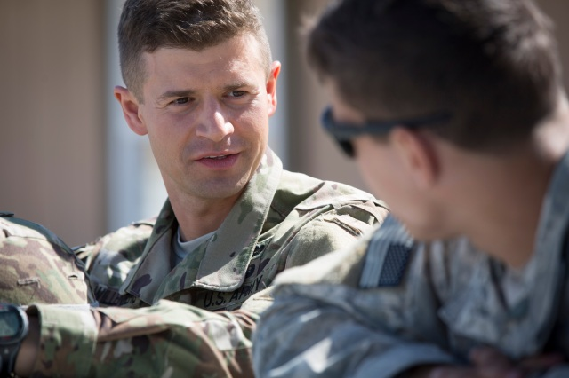 Father Lukasz J. Willenberg talks to a soldier at Camp Mackall Army Base in Southern Pines, N.C., shortly before they jumped out of an airplane during a military training exercise. Father Willenberg is a U.S. Army chaplain at Fort Bragg in Fayetteville, N.C., and trains as a noncombat paratrooper. (CNS/Chaz Muth)