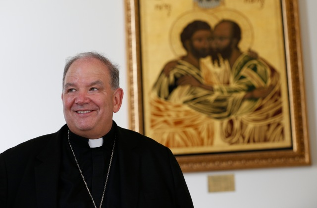 Archbishop Bernard A. Hebda of St. Paul and Minneapolis is pictured with an icon of Sts. Peter and Paul in the background at the Pontifical North American College in Rome June 29. Archbishop Hebda was among 25 new archbishops invited to the Vatican to attend Pope Francis' June 29 Mass with new archbishops from around the world. The Mass also marked the feast of Sts. Peter and Paul. (CNS/Paul Haring)
