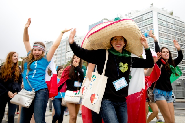 Mexican pilgrims march down Atlantic Avenue along Copacabana beach for the the opening Mass of World Youth Day in Rio de Janeiro July 23, 2013. The next worldwide Catholic youth festival will take place at the end of July in Poland. (CNS/Tyler Orsburn)
