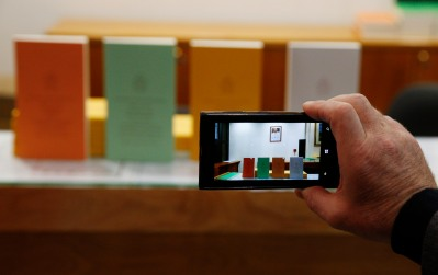 """Copies of Pope Francis' apostolic exhortation on the family, """"Amoris Laetitia"""" (""""The Joy of Love""""), are on display during the document's release in 2016. The exhortation was the concluding document of the 2014 and 2015 synods of bishops on the family. (CNS/Paul Haring)"""