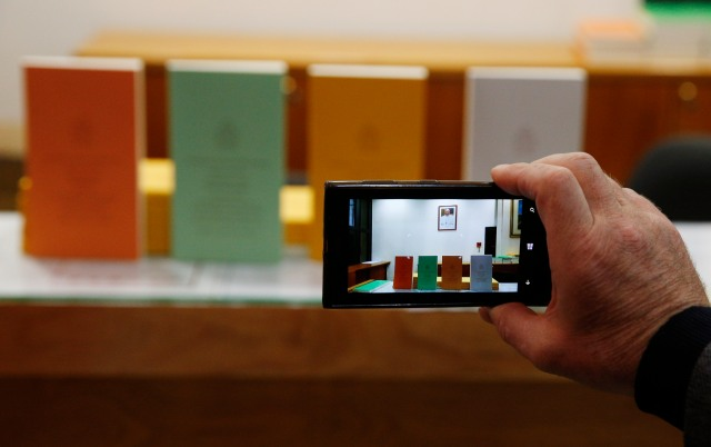 "A journalist takes photos of copies of Pope Francis' apostolic exhortation on the family, ""Amoris Laetitia"" (""The Joy of Love""), during the document's release at the Vatican April 8. The exhortation was the concluding document of the 2014 and 2015 synods of bishops on the family. (CNS/Paul Haring)"