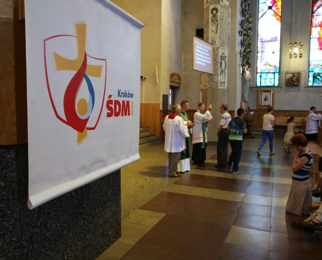 A banner for Wold Youth Day is displayed during Mass in the Church of Sts. Stanislaus Kostka and John Bosco in Krakow, Poland, July 24. Karol Wojtyla, who later became St. John Paul II, celebrated his first Mass as a priest in 1946 in the parish where he grew up. (CNS/Bob Roller)