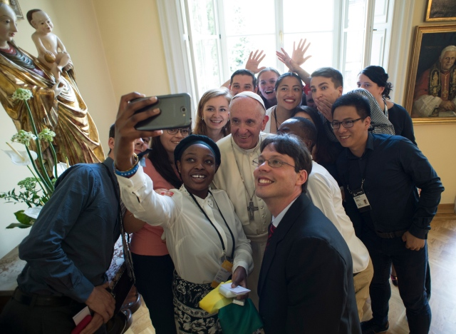 Pope Francis poses for a selfie with young people attending World Youth Day during a lunch in Krakow, Poland, July 30. (CNS/L'Osservatore Romano)