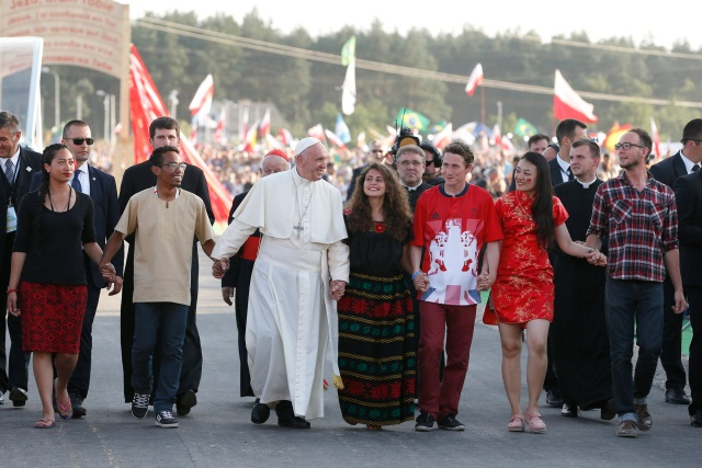 Pope Francis walks with World Youth Day pilgrims as he arrives for a July 30 prayer vigil at the Field of Mercy in Krakow, Poland. (CNS/Paul Haring)