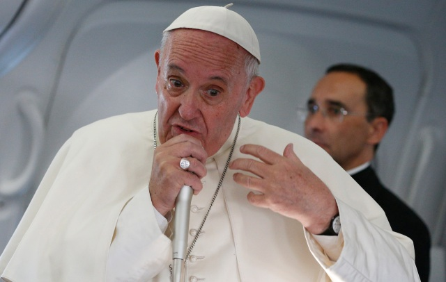 Pope Francis speaks with journalists aboard his July 31 flight from Krakow, Poland, to Rome. (CNS/Paul Haring)