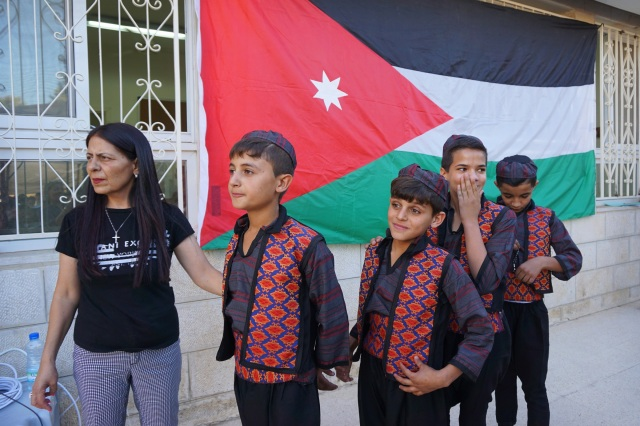 Syrian refugee boys line up to perform folk dances during a graduation ceremony at the Latin Patriarchate School in Naour, Jordan, July 11. (CNS photo/Dale Gavlak)