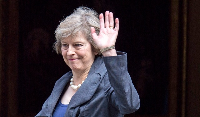 British Home Secretary Theresa May waves as she arrives July 12 to attend the last Cabinet meeting hosted by British Prime Minister David Cameron. Cardinal Vincent Nichols of Westminster said he is delighted by the appointment of May as Britain's new prime minister because of the commitment she has shown in the fight against human trafficking. (CNS photo/Will Oliver, EPA)
