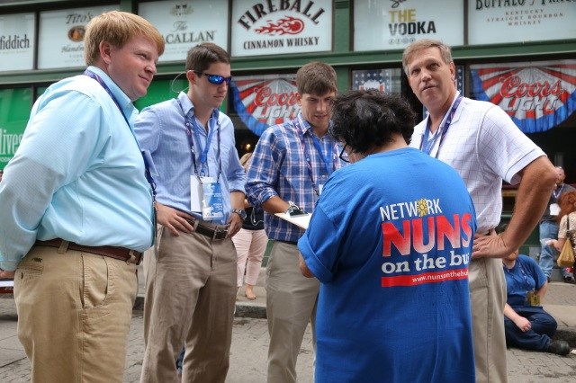 Sister Clare S. Lawlor, a Sister of St. Agnes and professor at Lewis University in Romeoville, Ill., collects information from bystanders July 18 outside the Republican National Convention in Cleveland. (CNS photo/William Rieter)