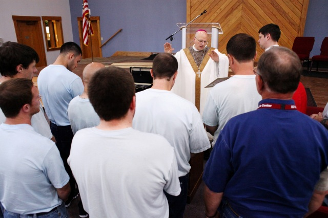 Bishop Edward J. Weisenburger of Salina, Kan., confirms seven men during a June 9 Mass at the Ellsworth Correctional Facility. (CNS photo/Karen Bonar, The Register)