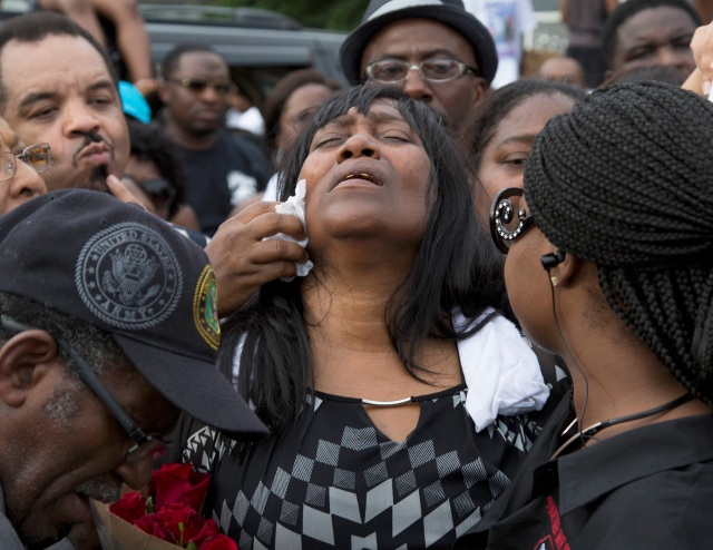 Sandra Sterling reacts during a July 7 vigil in memory of her nephew, Alton Sterling, who was shot dead by police outside a market in Baton Rouge, La. (CNS photo/Jeffrey Dubinsky, Reuters)