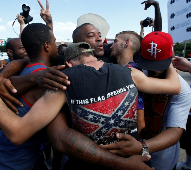 African-American and white men embrace after taking part in a prayer circle July 10 following a Black Lives Matter protest in Dallas. (CNS/Reuters)