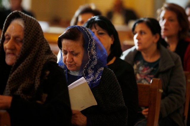 Iraqi Christians attend Mass at a church in Baghdad in 2015. (CNS file/Reuters)
