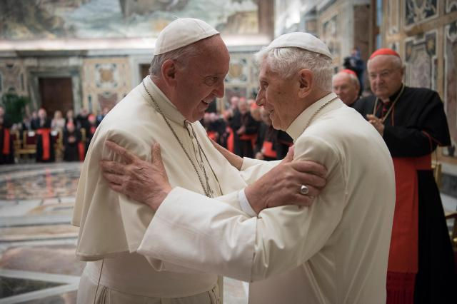 Pope Francis greets retired Pope Benedict XVI during a ceremony in June marking the 65th anniversary of the retired pope's priestly ordination. (CNS/L'Osservatore Romano)