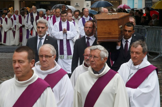 Pallbearers carry the coffin of Father Jacques Hamel Aug. 2 outside the cathedral in Rouen. (CNS/Reuters)