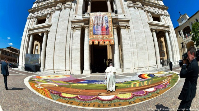 Pope Francis enters the Basilica of St. Mary of the Angels in Assisi, Italy, Aug. 4. (CNS/L'Osservatore Romano via Reuters)