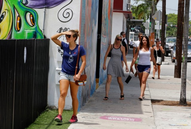 Visitors walk through the Wynwood arts district of Miami Aug. 3. During the first week of August, the Florida Department of Health reported its 16th case of locally transmitted Zika virus in a one-square-mile area of Miami north of downtown, bringing the total number of people infected in the mosquito-borne outbreak to at least 16. (CNS/Reuters)