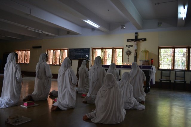 Nuns pray in Kolkata, India, Aug. 4. Although the Sept. 4 canonization of Blessed Teresa is in Rome, special festivities to honor her will continue in Kolkata until Christmas. (CNS/Saadia Azim)