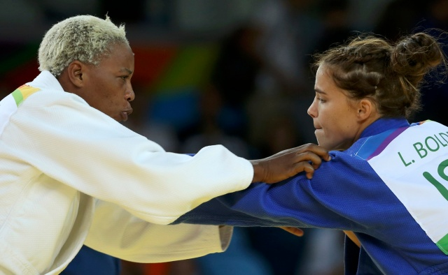 Refugee Olympic Team's Yolande Mabika, left, and Linda Bolder of Israel compete in judo during the Summer Olympics in Rio de Janeiro Aug. 10. (CNS/Reuters)