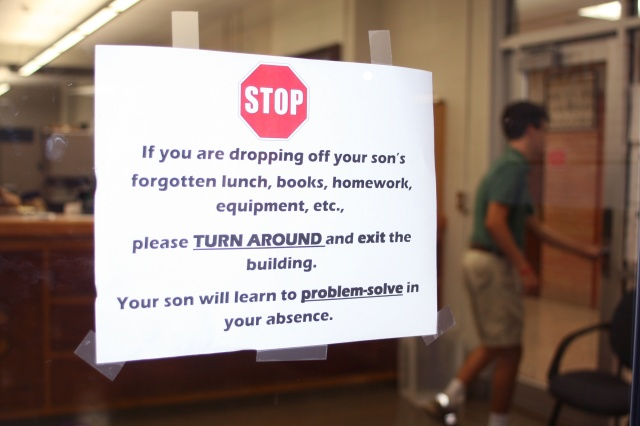 A sign reinforcing decades-old policies on problem-solving and personal responsibility is taped to a door at Catholic High School for Boys in Little Rock. (CNS/Aprille Hanson, Arkansas Catholic)