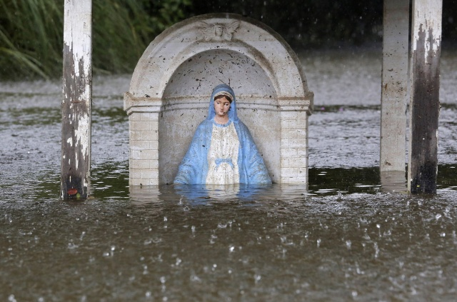 A statue is partially submerged in flood water in Sorrento, La., Aug. 20. (CNS/Reuters)