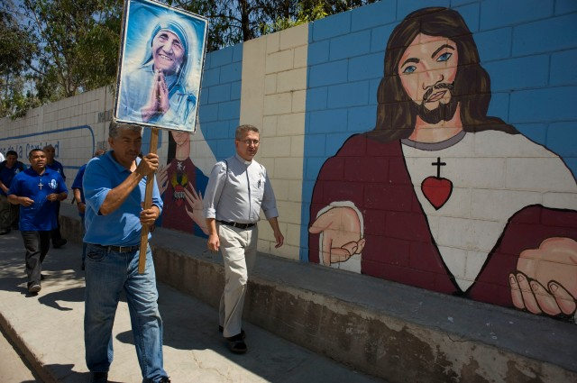 Father Zbigniew Szczotka, a member of the Missionaries of Charity Fathers, center, accompanies a group of men at the sanctuary of Blessed Teresa of Kolkata, as they begin a short walk to invite people to Mass in Tijuana. They are part of a group doing spiritual and community service with the Missionaries of Charity. (CNS/David Maung)