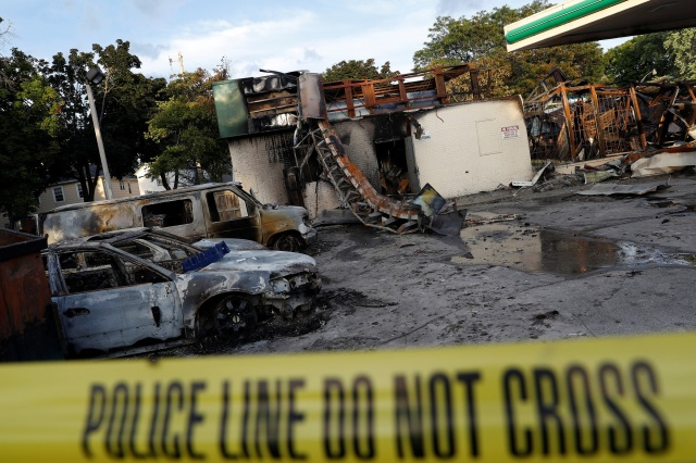 A gas station is seen Aug. 15 after it was burned down following the police shooting of a man in Milwaukee the previous day. (CNS photo/Aaron P. Bernstein, Reuters)