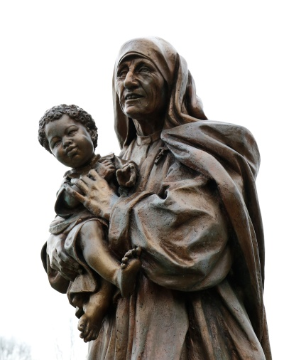 A statue of Blessed Teresa of Kolkata holding a child is seen in a prayer garden at Cure of Ars Church in Merrick, N.Y. On Sept. 4, Pope Francis, who has spent this year preaching about mercy, will canonize Mother Teresa, who traveled the world to deliver a single message: that love and caring are the most important things in the world. (CNS/Gregory A. Shemitz)