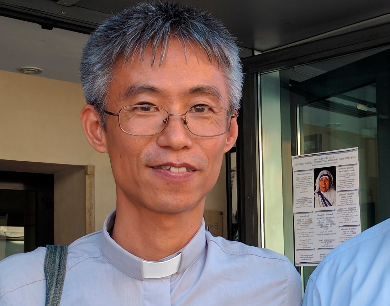 Missionaries of Charity Father Francisco Akihiro from Japan is pictured outside an exhibit on Blessed Teresa of Kolkata in Rome Sept. 2. (CNS/Junno Arocho Esteves)