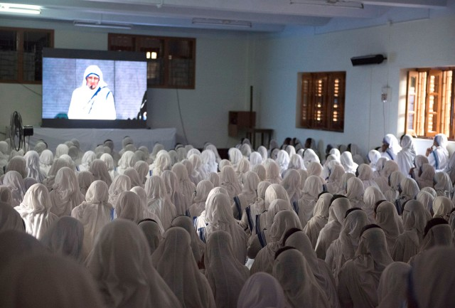 Missionaries of Charity nuns in Kolkata, India, watch St. Teresa's canonization broadcast live from Rome Sept. 4. (CNS photo/Jeffrey Bruno)