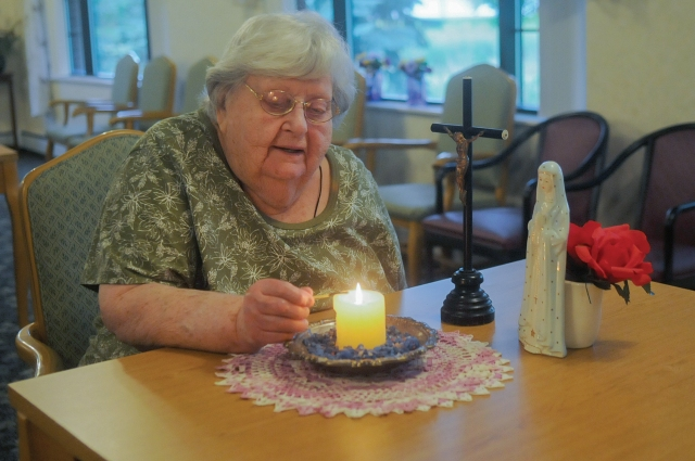 Agnes Imdieke of Albany, Minn., pictured Sept. 6, has been lighting a candle for Jacob Wetterling every morning since he disappeared in October 1989. A Minnesota man confessed to kidnapping and killing the boy. (CNS/Dianne Towalski, The Visitor)