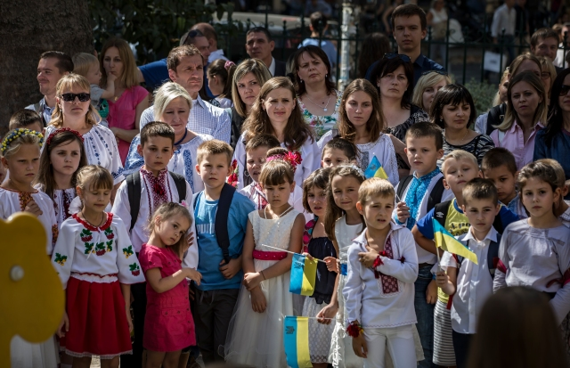 Families from the Ukrainian community of Paris gather Sept. 3 outside St. Volodymyr the Great Cathedral to mark the beginning of a new school year at the Ukrainian parish in Paris. (CNS/EPA)