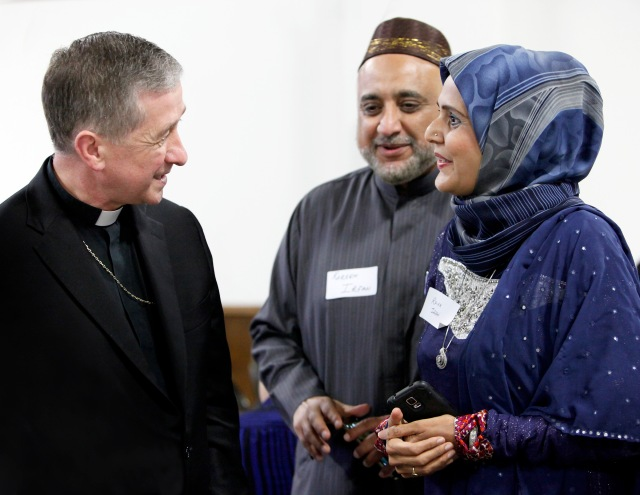 "Chicago Cardinal Blase J. Cupich, seen here last summer at a Catholic-Muslim dinner in Bridgeview, Ill., said the first weekend of President Trump's order to turn away refugees from America was ""a dark moment in U.S. history."" (CNS/Karen Callaway/Chicago Catholic)"