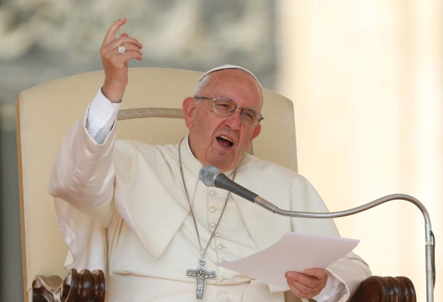 Pope Francis speaks during his general audience in St. Peter's Square at the Vatican Sept. 14. (CNS/Paul Haring)