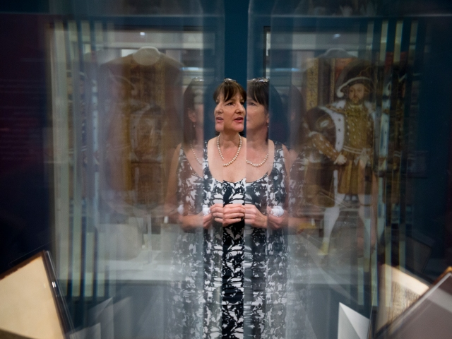 Janet Graffius, curator of collections at Stonyhurst College in England, is reflected in exhibit glass containing St. Thomas More artifacts at the St. John Paul II National Shrine in Washington Sept. 15. The shrine's exhibit of More artifacts will be open until March 31, 2017. (CNS/Tyler Orsburn)