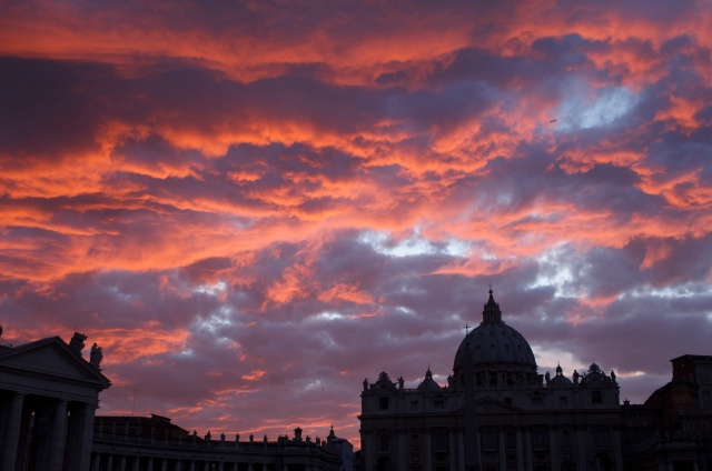 St. Peter's Basilica is seen during sunset in Rome in a 2011 file photo. Pope Francis has approved revised norms for the Congregation for Saints' Causes regarding medical consultations on healings alleged to be miracles. (CNS/Paul Haring)
