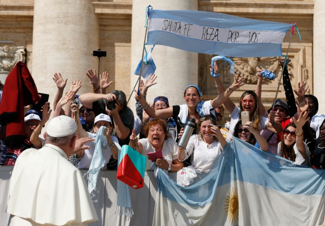 Pope Francis greets pilgrims from Argentina during his general audience in St. Peter's Square at the Vatican Sept. 14. (CNS photo/Paul Haring)