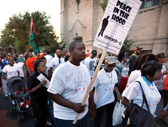 Participants walk during a call for an end to violence in their community June 17 in Chicago. The march followed a rally in front of St. Sabina Church. (CNS photo/Karen Callaway, Catholic New World)