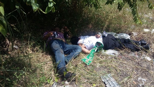 The bodies of Fathers Alejo Nabor Jimenez Juarez and Jose Alfredo Juarez de la Cruz are seen along a roadside Sept. 19 in the Mexican state of Veracruz.(CNS photo/Diario Marcha, Handout via EPA)